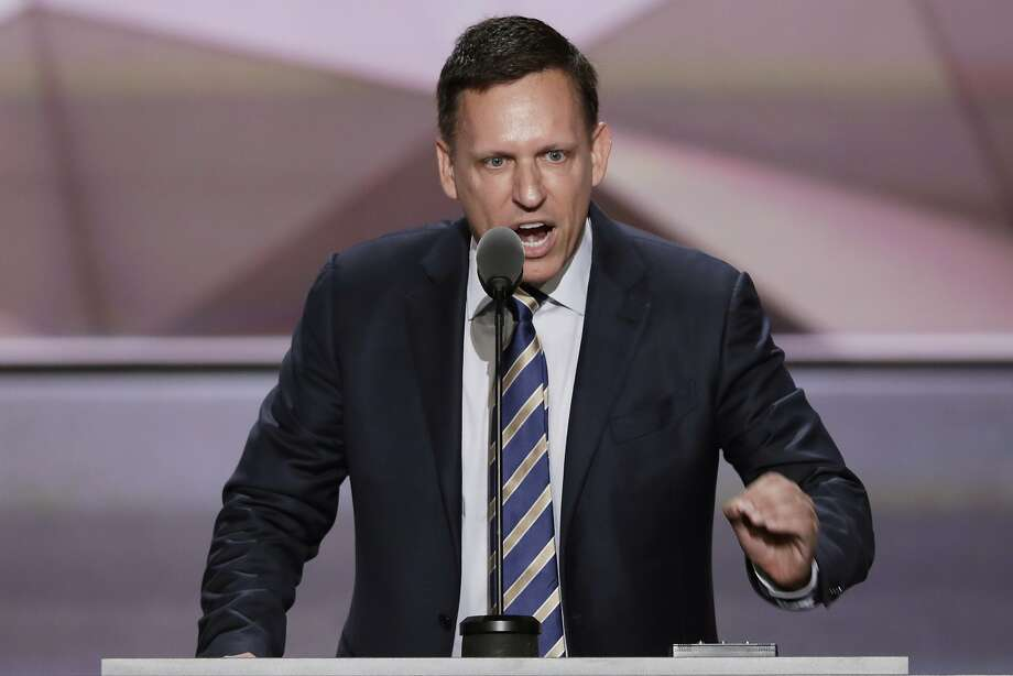 "In this July 21, 2016, file photo, entrepreneur Peter Thiel speaks during the final day of the Republican National Convention in Cleveland. Thiel questioned the global push toward restricting carbon emissions as ""group think"" while speaking Tuesday at an international energy conference in Houston. Photo: J. Scott Applewhite, Associated Press"