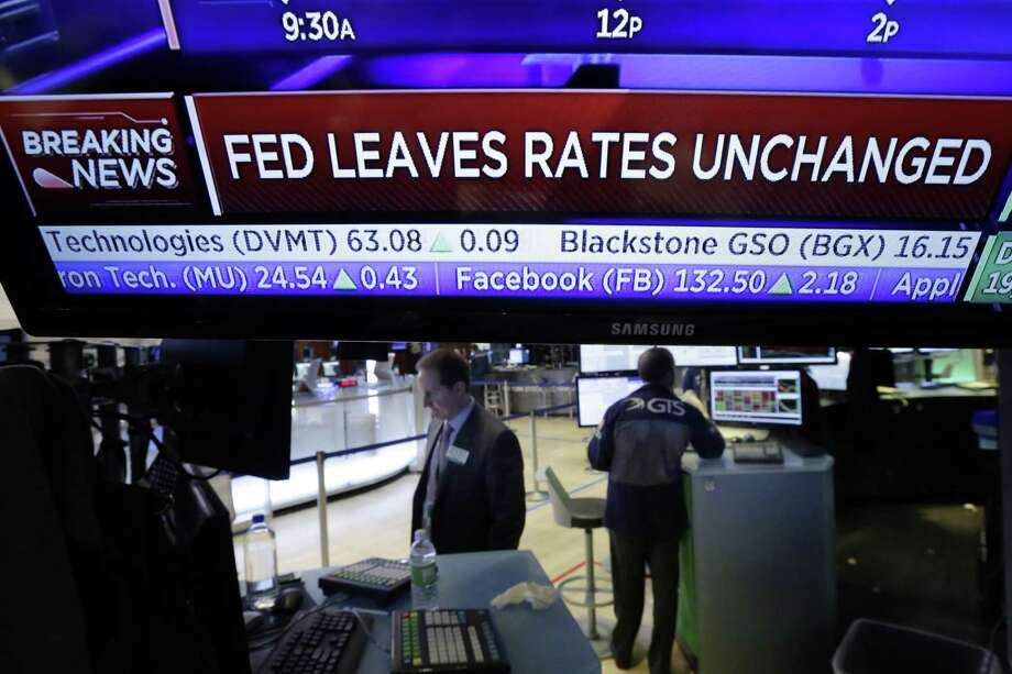 A television screen on the floor of the New York Stock Exchange shows the Fed's rate decision Wednesday. The Federal Reserve has left its key interest rate unchanged at a time of solid economic gains but also heightened uncertainty surrounding the new Trump administration. Photo: Richard Drew /Associated Press / AP