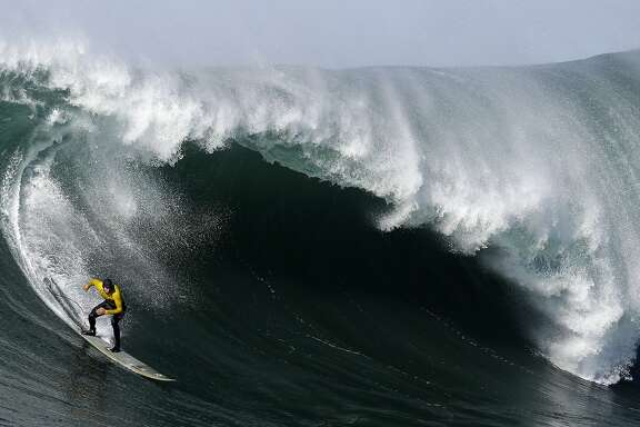 FILE - In this Jan. 20, 2013, file photo, Greg Long competes during the third heat of the Mavericks surf competition in Half Moon Bay, Calif. The organizers of the Titans of Mavericks big wave surf contest have filed for bankruptcy.  The Santa Cruz Sentinel reports that contest organizers Cartel Management Inc. and Titans of Mavericks LLC filed for Chapter 11 bankruptcy on Tuesday, Jan. 31, 2017.  (AP Photo/Marcio Jose Sanchez, File)