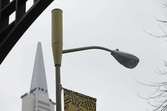 An antenna enclosure for a small cell is seen on top of a light pole on Wednesday, February 2, 2017 in San Francisco, Calif.