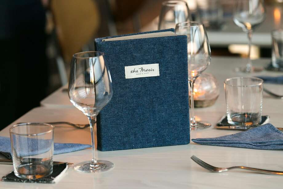 A 60-page wine menu dressed in demin sits on a table at the Morris in S.F. Photo: Jen Fedrizzi, Special To The Chronicle