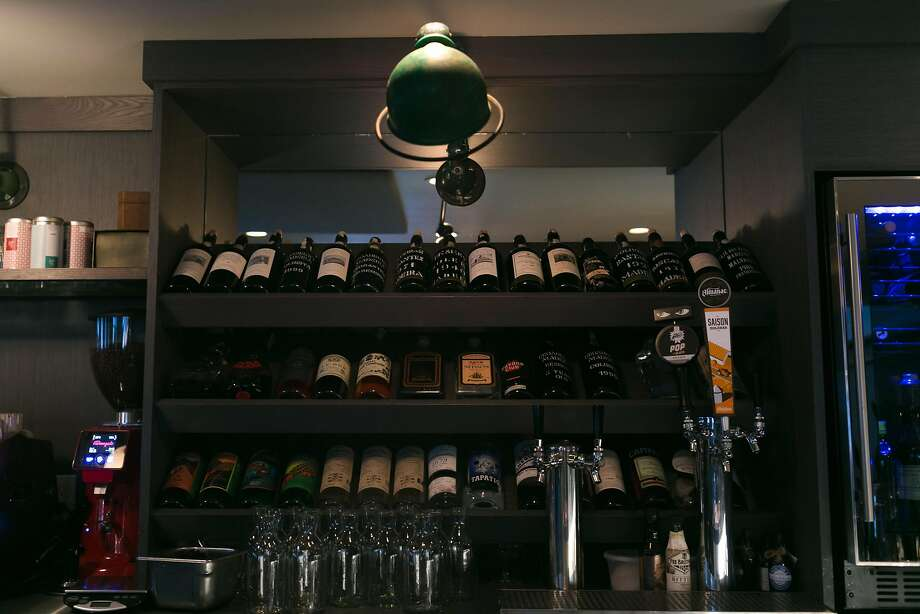 The Madeira wine selection is on the top shelf behind the bar at the Morris in S.F. Photo: Jen Fedrizzi, Special To The Chronicle