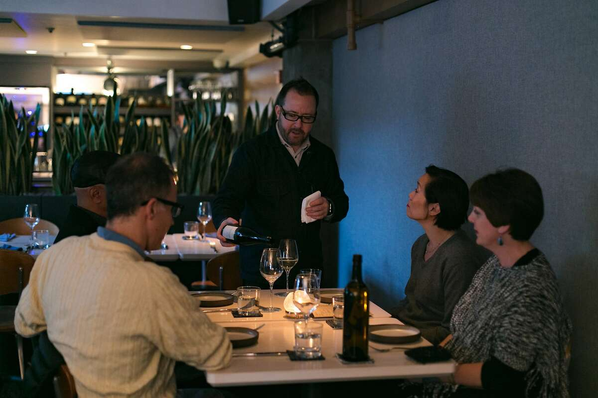Owner Paul Einbund pours wine from guests at The Morris in S.F.