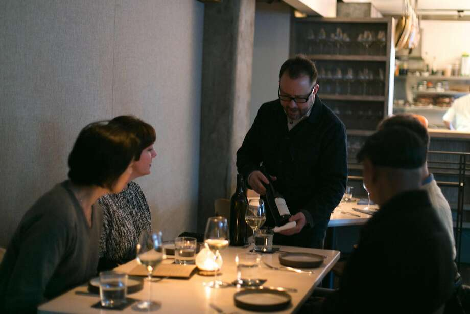 Owner Paul Einbund pours wine at the Morris in S.F. Photo: Jen Fedrizzi, Special To The Chronicle