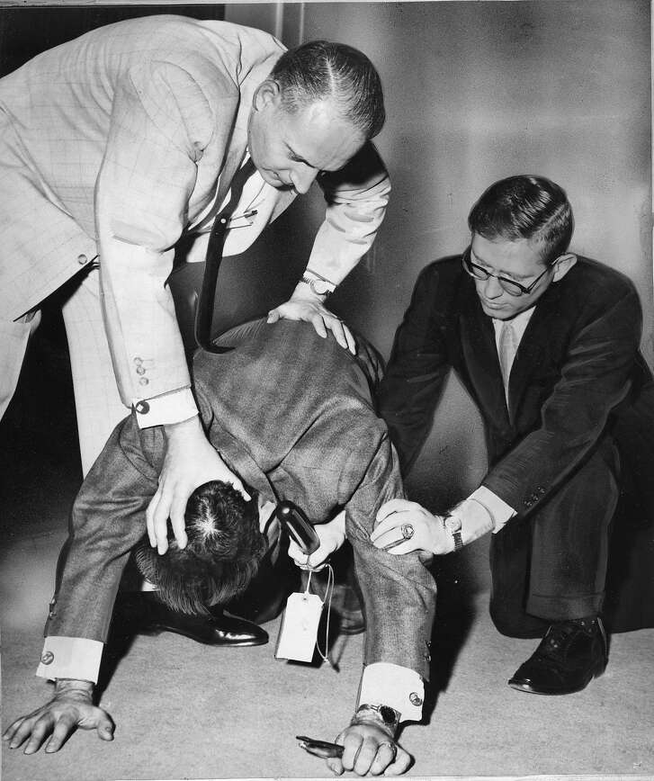 Robert Meisenbach, UC Berkeley student on trial for striking a police office at the HUAC protests at the San Francisco City Hall Here at the trial, his lawyers Charles Garry (top) and Jack Bernan bottom, demonstrate how Meisenbach was beaten  photo ran 04/27/1961, P. 5