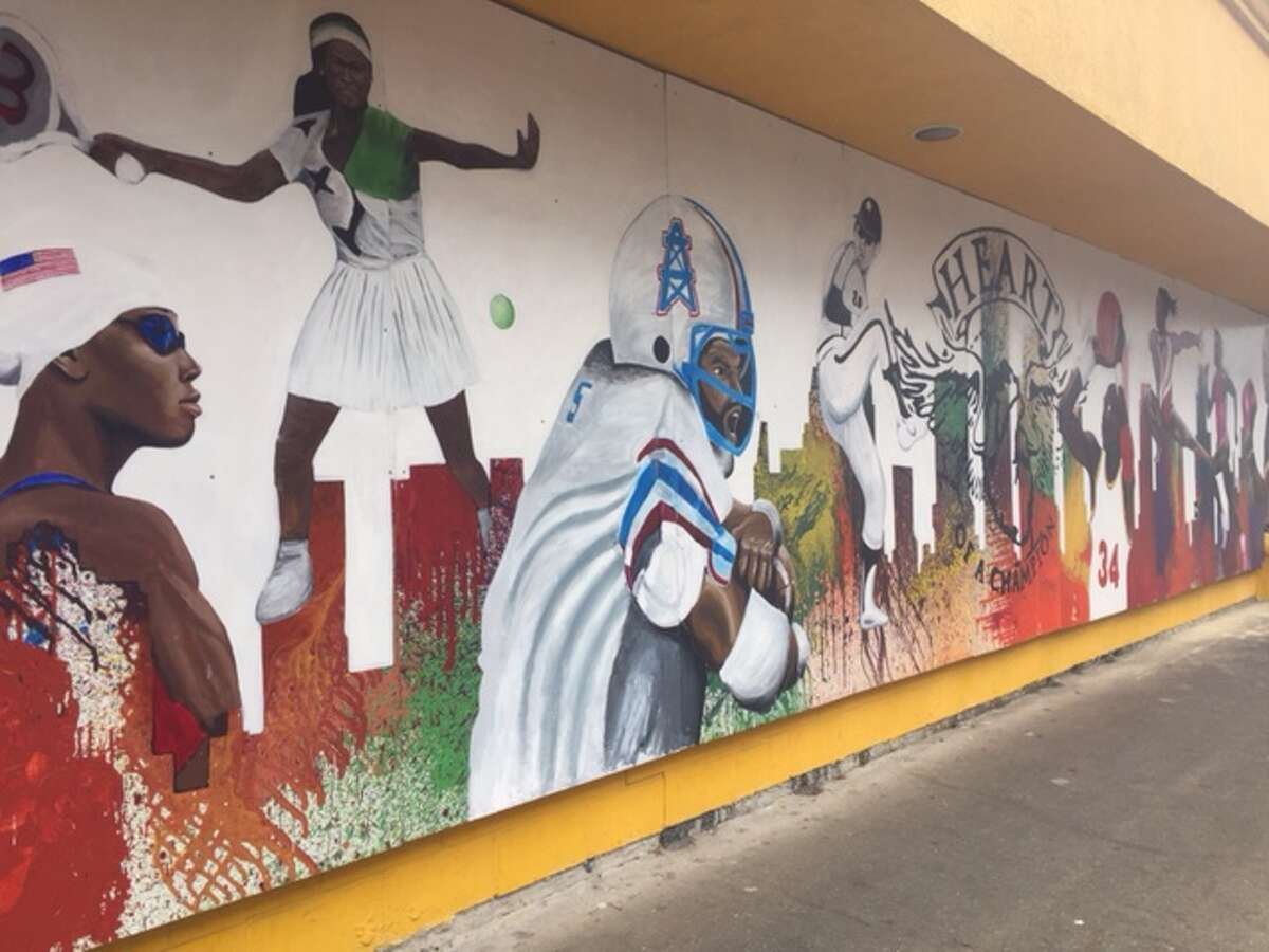 """""""Heart of a Champion,"""" at the Breakfast Klub, is one of four murals by Houston artist Reginald C. Adams in collaboration with area students for a Super Bowl Host Committee commission."""