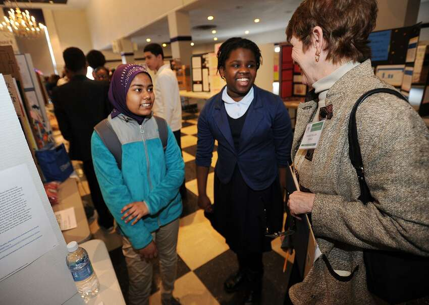 Finalists Sunzidah Choudhury, left, and Joanna Lousime, both 12, seventh graders at Curiale School in Bridgeport, present their project to judge Marge Hiller at the city's Middle School Science Fair at the University of Bridgeport in Bridgeport, Conn. on Wednesday, February 1, 2017. One hundred and forty four projects were entered by seventh and eighth graders representing twenty two different schools. A group of the highest scoring projects will move on to the State Science Fair held annually at Quinnipiac University.