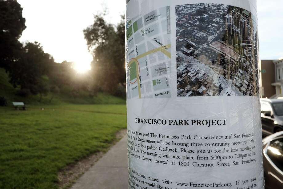 A sign announcing community meetings to decide the fate of the Francisco Reservoir is taped to a pole next to the park. Photo: Michael Short, Special To The Chronicle