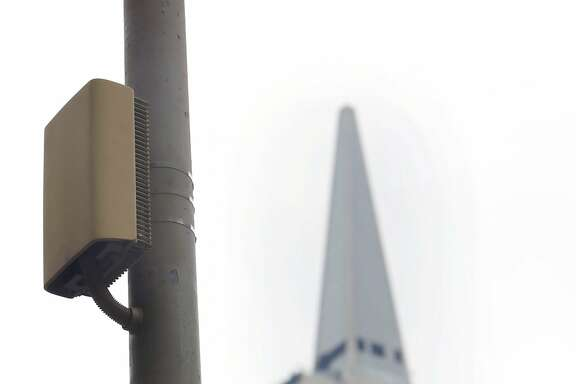 The power amplifier for a small cell is seen on a light pole on Wednesday, February 2, 2017 in San Francisco, Calif.