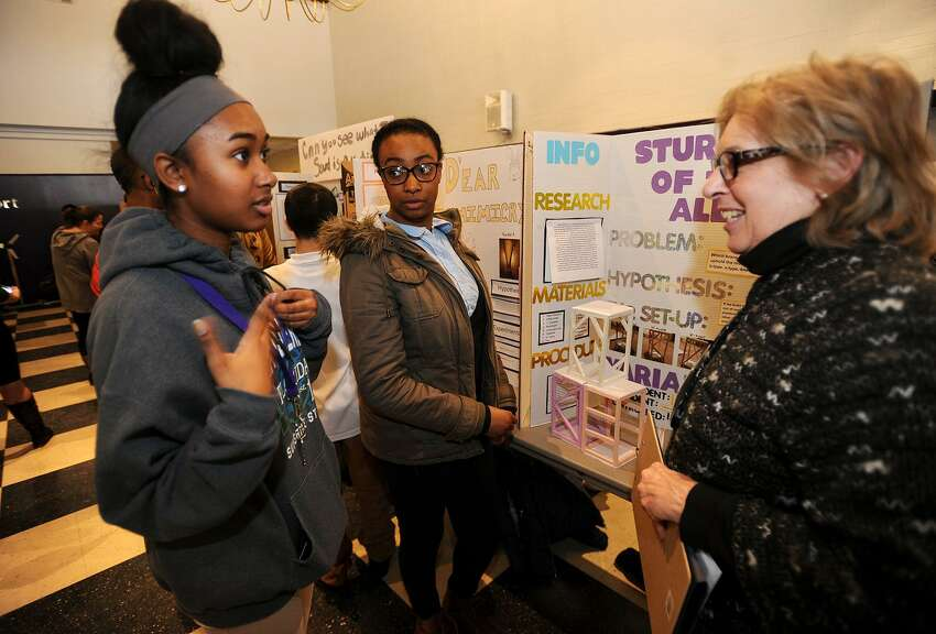 Kayla Keddo, left, and Dea'Ja Jones, both 13, eighth graders at High Horizons Magnet School in Bridgeport, present their project to judge Ann Langley, a retired Bridgeport teacher, at the city's Middle School Science Fair at the University of Bridgeport in Bridgeport, Conn. on Wednesday, February 1, 2017. One hundred and forty four projects were entered by seventh and eighth graders representing twenty two different schools. A group of the highest scoring projects will move on to the State Science Fair held annually at Quinnipiac University.