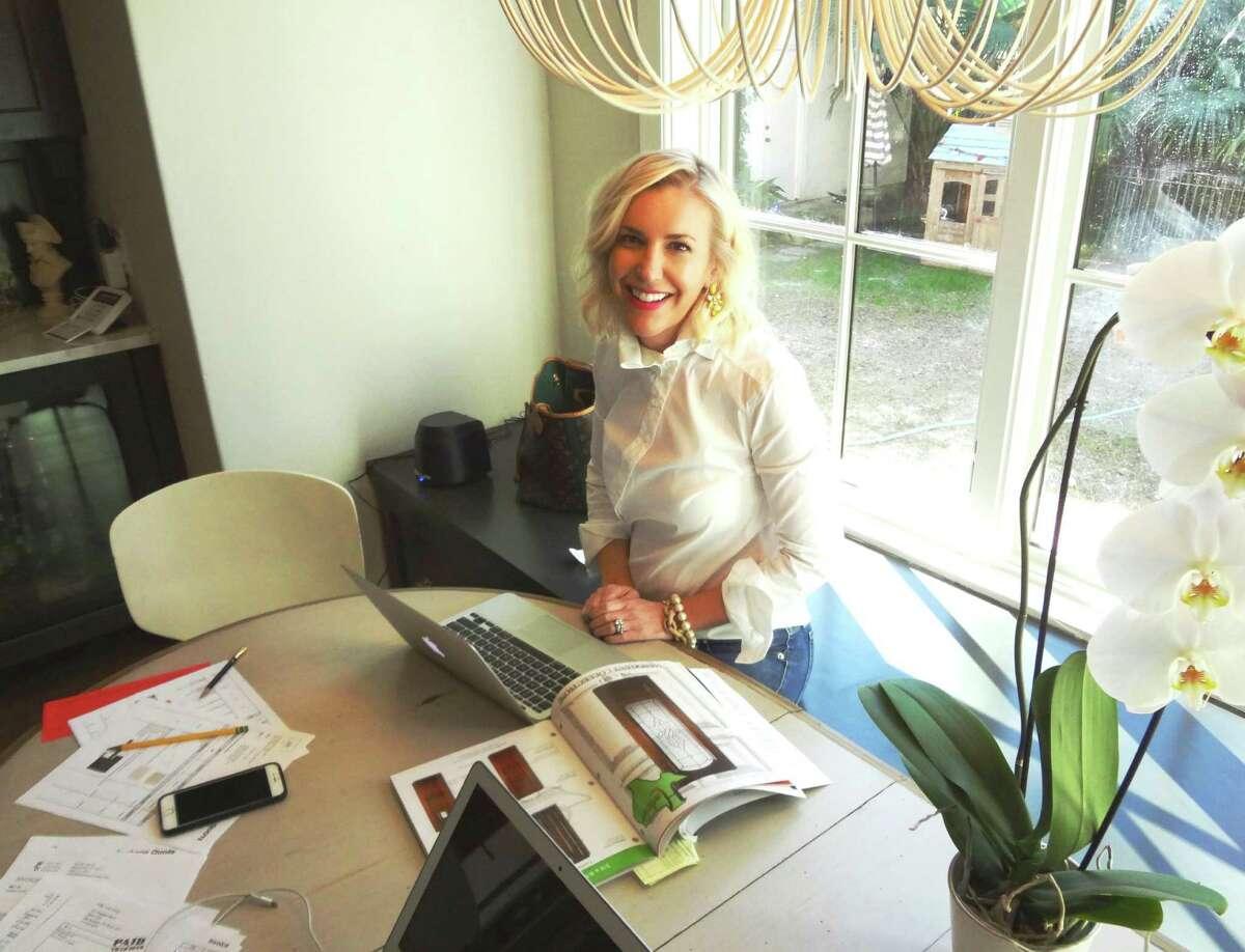 SCHONES: Interior designer Whitney Schones works at her kitchen table in her Olmos Park home.