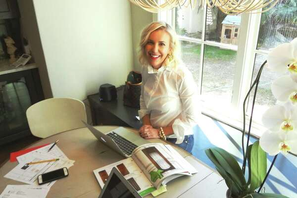 SCHONES: Interior designer Whitney Schones works at her kitchen table in her Olmos Park home.