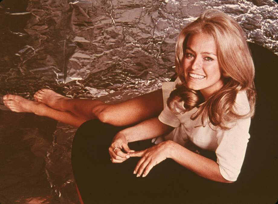PHOTOS: Remembering Farrah Fawcett's many looks through the years  This week in 1947, the TV legend and pin-up idol was born in Corpus Christi. We're looking back at pictures of the late celeb through the years.  Click through to see her progression... Photo: Fotos International/Getty Images