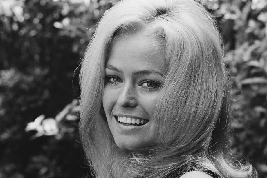 "BAYOU CITY JUKEBOX: Songs that mention HoustonThe song ""Midnight Train to Georgia,"" was originally written as ""Midnight Plane to Houston"" after its songwriter heard then-model Farrah Fawcett use the phrase in conversation.Click through to learn about some classic cuts that mention the city of Houston in the lyrics... Photo: Harry Benson/Getty Images"