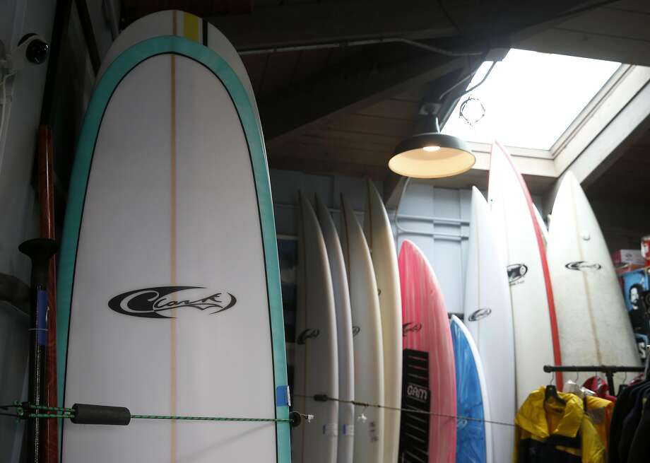 Surfboards designed by Mavericks surf contest founder Jeff Clark are sold in his shop at Pillar Point Harbor in Half Moon Bay, Calif. on Wednesday, Feb. 1, 2017. Clark's surf shop is thriving, but organizers of the Titans of Mavericks surf contest have filed for bankruptcy. Photo: Paul Chinn, The Chronicle
