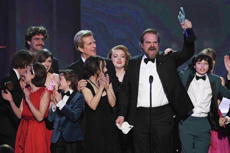 From left, actors Millie Bobby Brown, Natalia Dyer, John Paul Reynolds, Noah Schnapp, Winona Ryder, Matthew Modine, Shannon Purser, David Harbour, and Finn Wolfhard of 'Stranger Things' accept Outstanding Performance by an Ensemble in a Drama Series onstage during The 23rd Annual Screen Actors Guild Awards at The Shrine Auditorium Sunday. Many winners that night sounded alarms about the president's travel and refugee ban. Photo: Kevin Winter /Getty Images / 2017 Getty Images