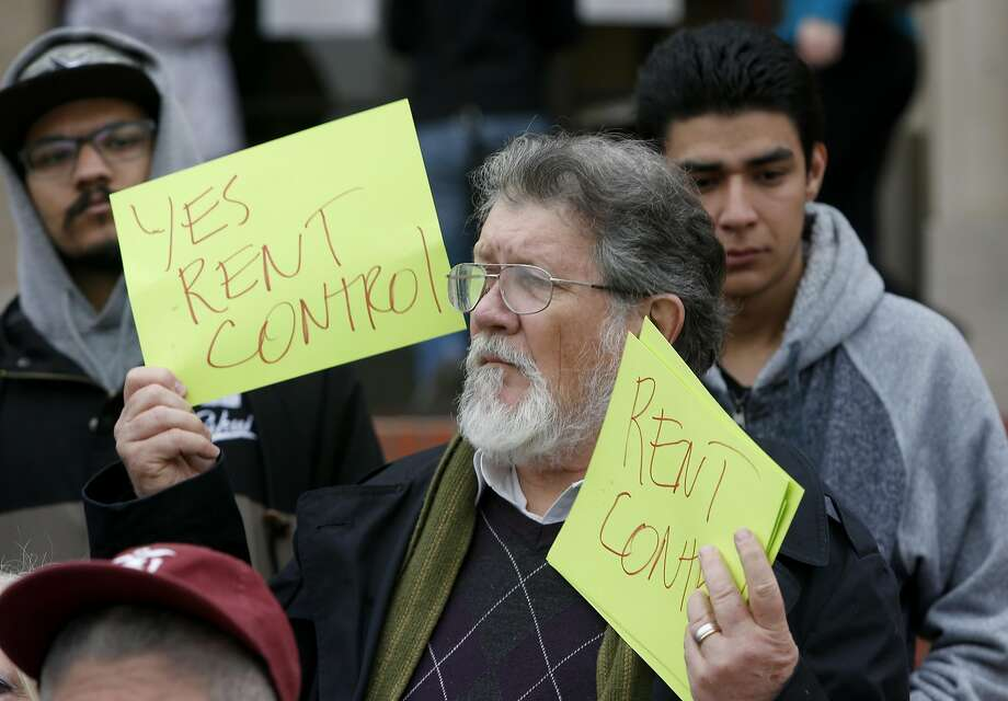 Juan Reardon and other tenants rights advocates protest in front of the Contra Costa County Courthouse before a hearing is held in Martinez, Calif. on Wednesday, Feb. 1, 2017. Richmond's new rent control law will remain in effect, at least for now, after a state court judge denied the California Apartment Association's request for a preliminary injunction. Photo: Paul Chinn, The Chronicle