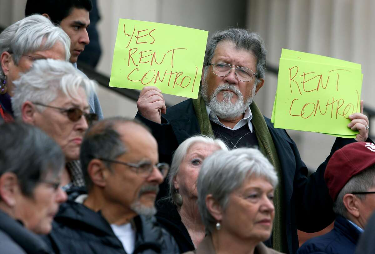 Juan Reardon and other tenants rights advocates protest in front of the Contra Costa County Courthouse before a hearing is held in Martinez, Calif. on Wednesday, Feb. 1, 2017. Richmond voters approved a rent control measure in November but a group of property owners is seeking an injunction to stop its implementation.