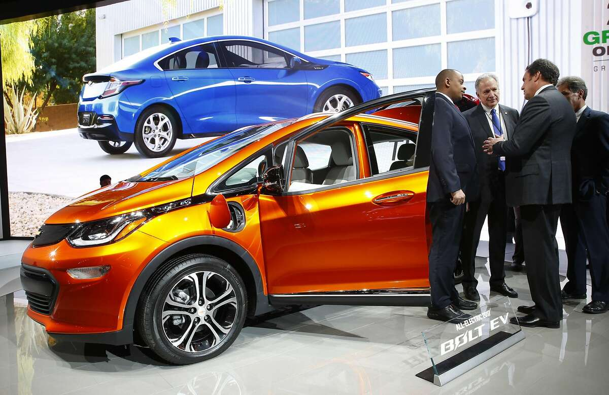 U.S. Transportation Secretary Anthony Foxx, from left, and National Highway Traffic Safety Administration Administrator Mark Rosekind listen to Mark Reuss, General Motors Executive Vice President of Global Product Development talk about the 2017 Chevrolet Bolt EV at the North American International Auto Show in Detroit, Thursday, Jan. 14, 2016. Foxx said Thursday that the National Highway Traffic Safety Administration also will develop a model policy for states to follow if they decide to allow autonomous cars on public roads. That policy � which will be developed within six months � could help form the basis of a consistent national policy. (AP Photo/Paul Sancya)