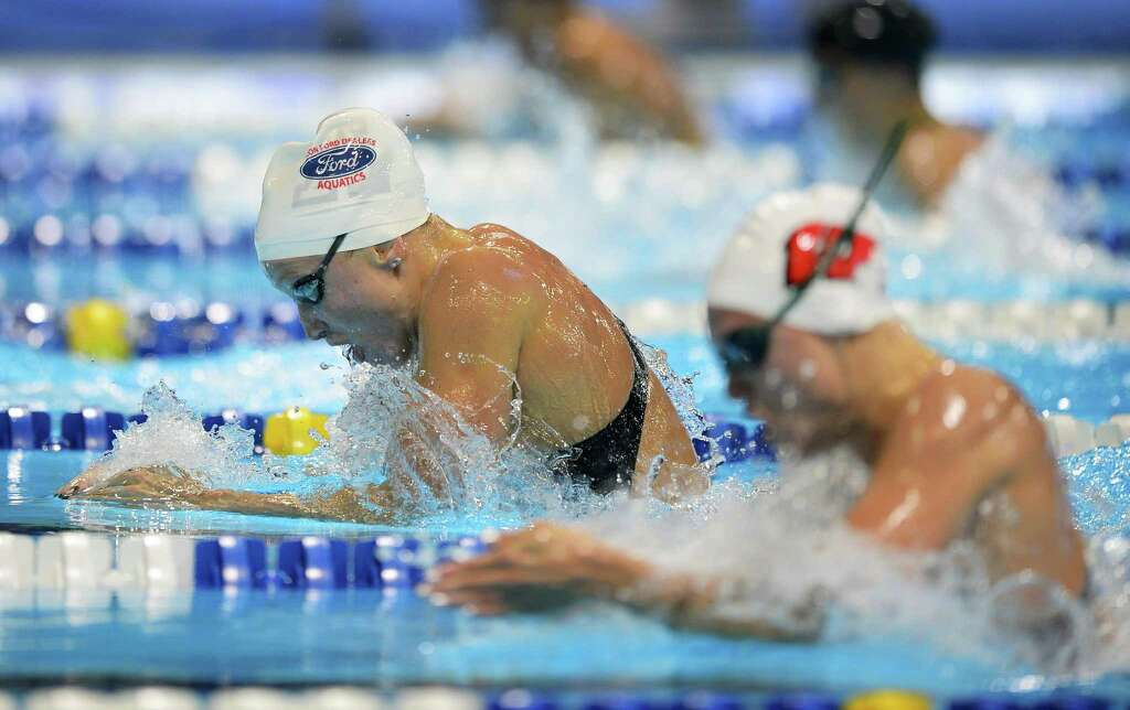 annie chandler left swims in the womens 100 meter breaststroke preliminaries at the