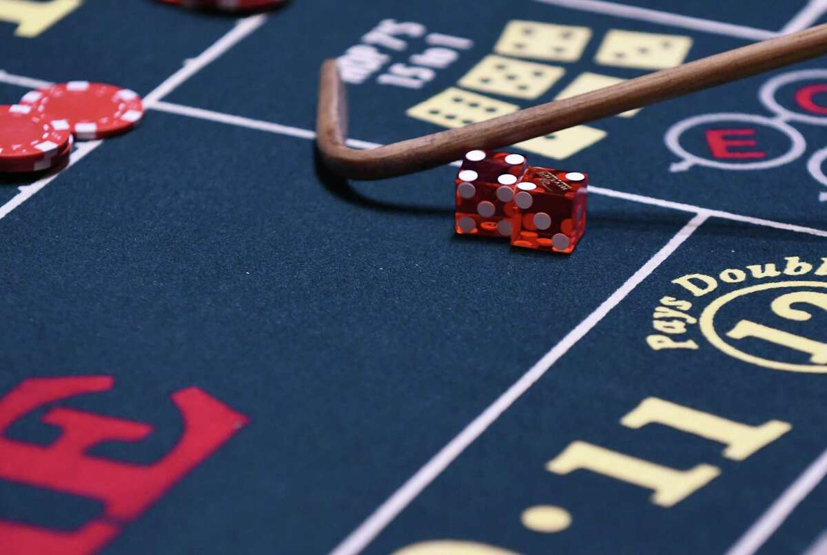 Dice on a craps table at Rivers Casino & Resort on Wednesday, Feb. 1, 2017, during a media tour in Schenectady, N.Y. The game was used a training exercise for casino employees using faux money. (Will Waldron/Times Union)
