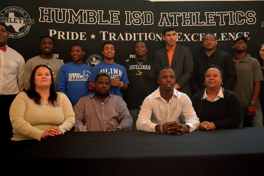 Terio Brown, center, of Humble High School, is all smiles after signing his letter of intent to play football for Texas State University during the Humble ISD Athletics Signing Day at The Overlook in Atascocita on Feb. 1, 2017. (Photo by Jerry Baker/Freelance) Photo: Jerry Baker, For The Chronicle / Freelance