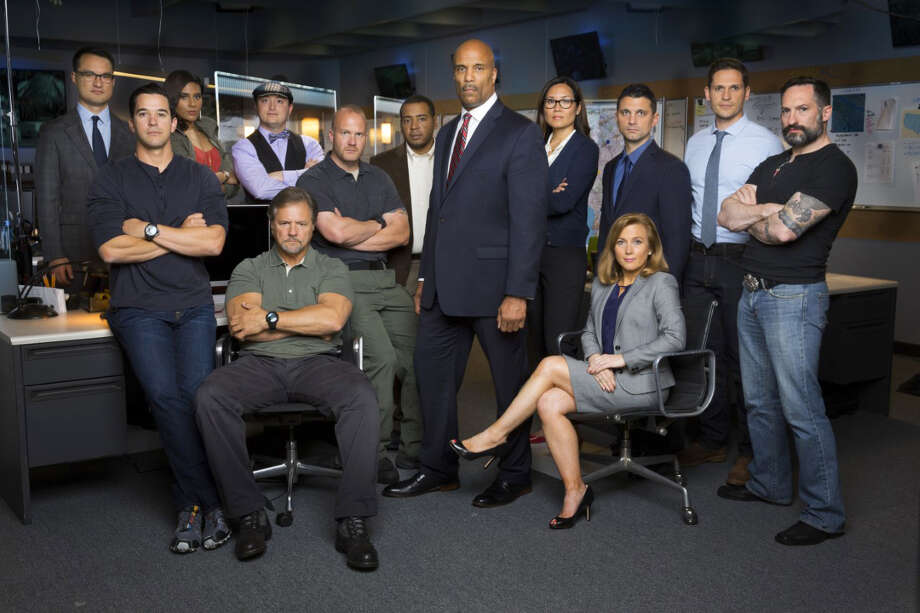 "The cast of the CBS show ""Hunted,"" including Theresa Payton, seated. MUST CREDIT: Cliff Lipson, CBS Photo: Cliff Lipson / CBS"
