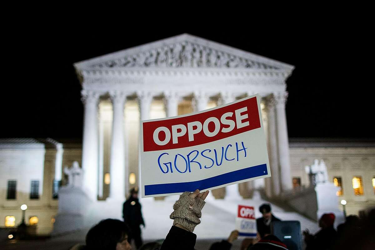 WASHINGTON, DC - JANUARY 31: Protestors gather outside of the Supreme Court, January 31, 2017 in Washington, DC. President Donald Trump announced on Tuesday night that he intends to nominate Neil Gorsuch to the Supreme Court. Gorsuch is a U.S. Circuit Judge of the U.S. Court of Appeals for the Tenth Circuit. If confirmed, Gorsuch will take the seat that has been vacant since the February 2016 death of Justice Antonin Scalia. (Photo by Drew Angerer/Getty Images)