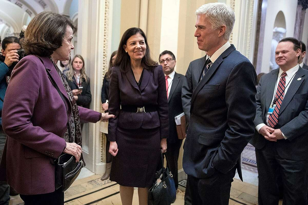 WASHINGTON, DC - FEBRUARY 01: Former Republican senator Kelly Ayotte (C) introduces U.S. Supreme Court nominee Judge Neil Gorsuch (R) to Senate Judiciary Committee ranking member Sen. Dianne Feinstein (D-CA) in the hallway of the U.S. Capitol February 1,