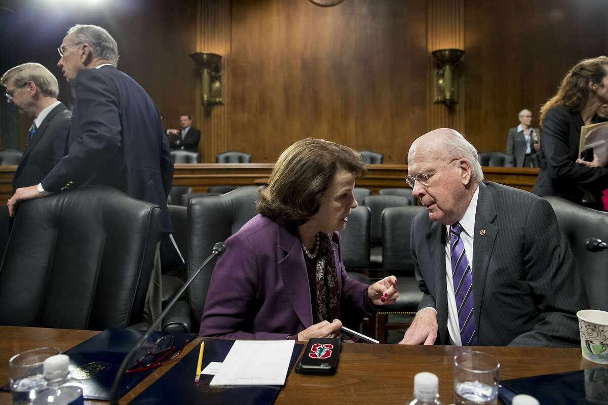 Sen. Dianne Feinstein, D-Calif., ranking member on the Senate Judiciary Committee, confers with Sen. Patrick Leahy, D-Vt. on Capitol Hill in Washington, Wednesday, Feb. 1, 2017, after the panel voted to approve the nomination of Attorney General-designate Sen. Jeff Sessions, R-Ala., following angry exchanges between Republicans and Democrats. Committee Chairman Sen. Chuck Grassley, R-Iowa, departs at upper left. (AP Photo/J. Scott Applewhite)