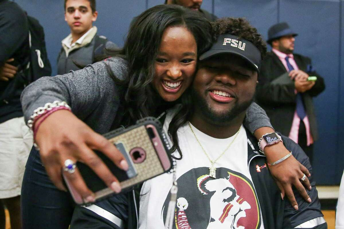 Bryan Dalco, left, who flew in from Washington D.C., takes a selfie with Episcopal defensive tackle Marvin Wilson after he announced he will be attending Florida State University during national signing day Wednesday, Feb. 1, 2017 in Houston.