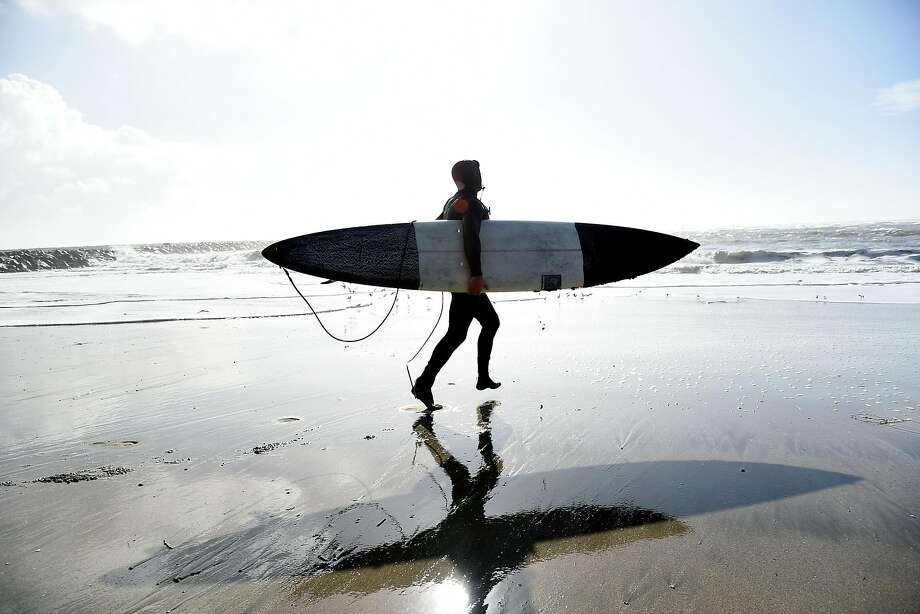 Jamie Williams, of San Francisco heads out to the water as he prepares to surf at Maverick's in Half Moon Bay, CA Wednesday, January 7, 2016. Photo: Michael Short, Special To The Chronicle