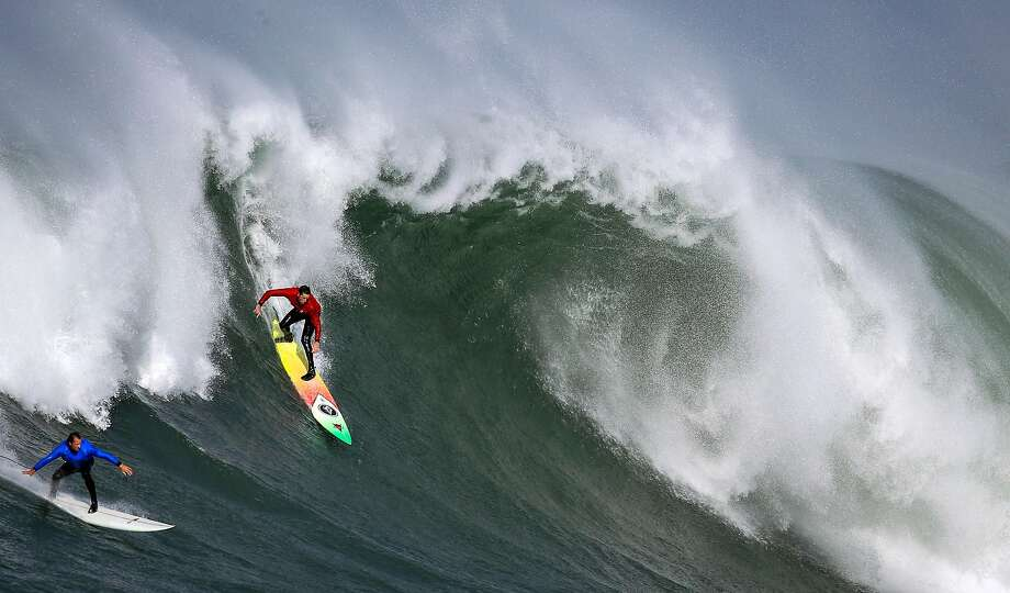 Officials are keeping an eye on Thursday as a possible day for the Mavericks big-wave surf contest. (PHOTO: Ken Collins (red) and Chris Bertish (blue) try to get on a wave in heat number two in the first round of the Titans of Mavericks competition in Half Moon Bay, Calif., on Friday, Feb. 12, 2016.) Photo: Carlos Avila Gonzalez, The Chronicle