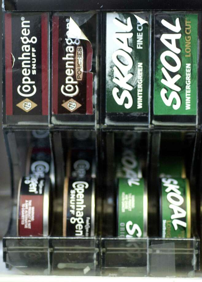 A file photo of Copenhagen and Skoal tins on display in Stamford, Conn., produced by U.S. Smokeless Tobacco. Mark Conrad/Staff photo Photo: Mark Conrad / ST / NORWALK HOUR OUT