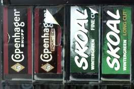 A file photo of Copenhagen and Skoal tins on display in Stamford, Conn., produced by U.S. Smokeless Tobacco. Mark Conrad/Staff photo