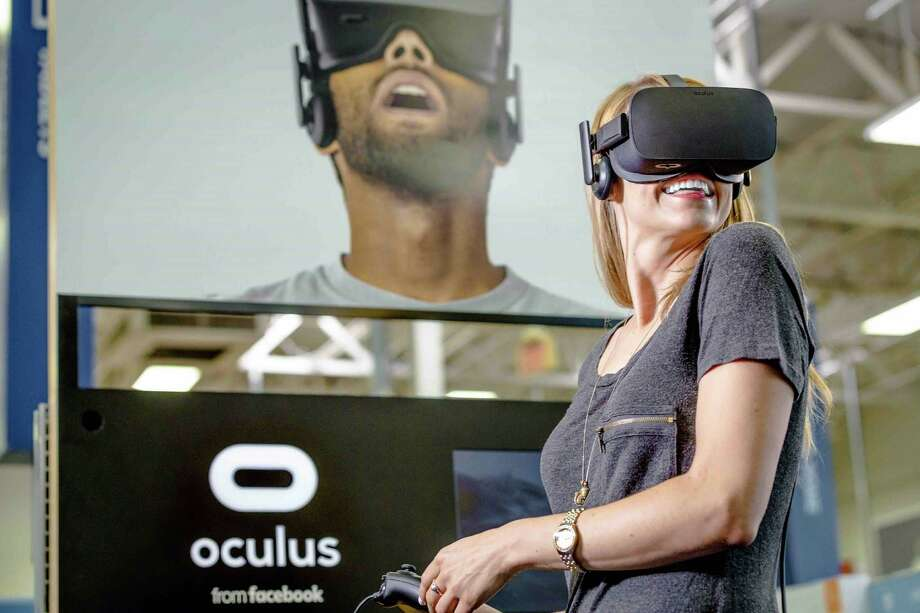 Facebook's acquisition of Oculus gave it a head start against Microsoft Corp., Sony Corp., Alphabet Inc.'s Google and others competing for a piece of the virtual reality market that's forecast to exceed $84 billion in sales in 2020. Facebook began shipping the ski-goggle-like Rift for $599 in March. Shown is a demonstration of Facebook's Oculus Rift headsets. Photo: Best Buy / Best Buy