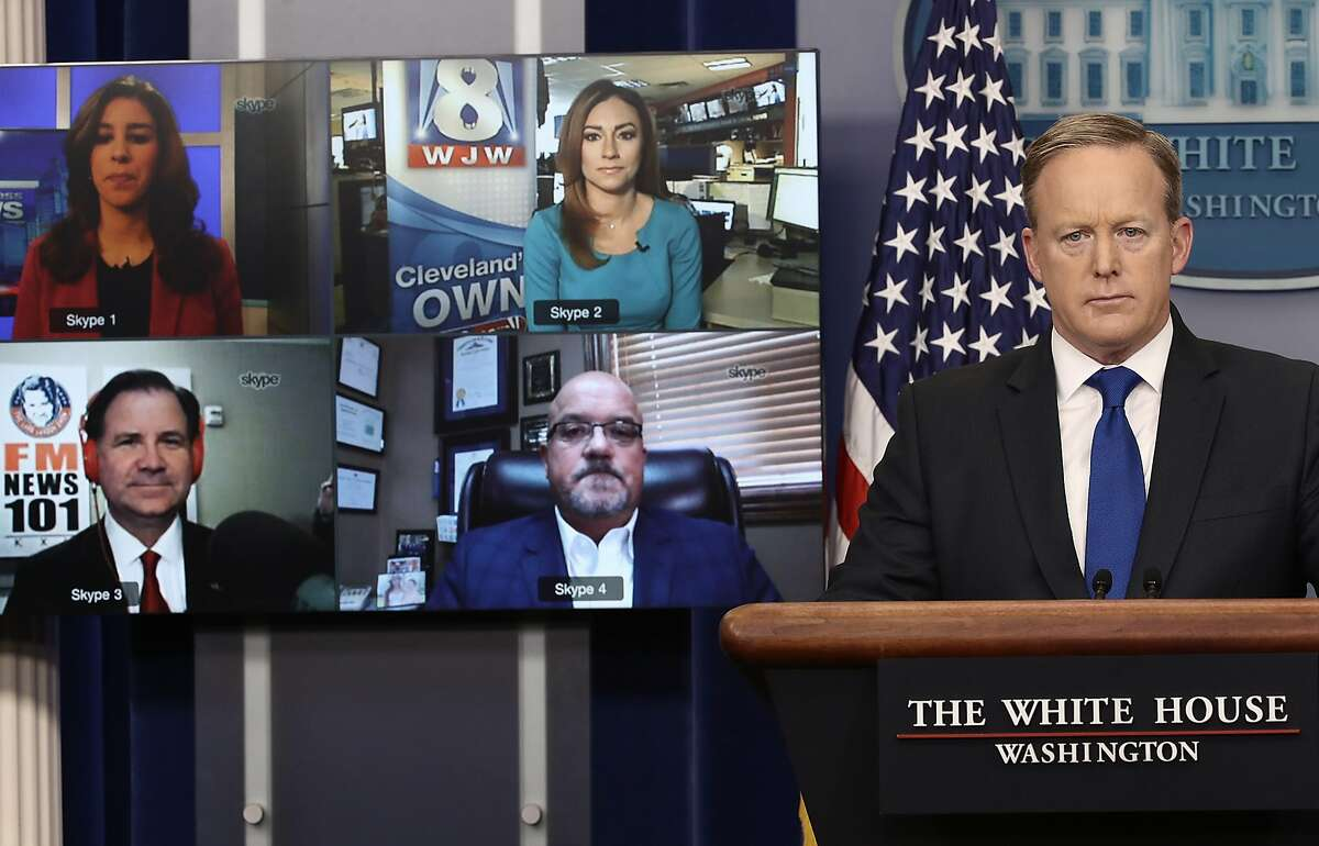 White House Press Secretary Sean Spicer answers questions from reporters via Skype in Washington. The