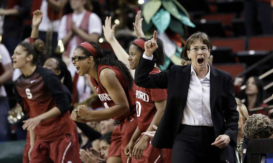 Stanford coach Tara VanDerveer lets out a yell as her bench reacts behind on a free throw made by the team against Arizona State in the final seconds of an NCAA college basketball game in the semifinals of the Pac-12 Conference tournament, March 7, 2015. Photo: Elaine Thompson, Associated Press