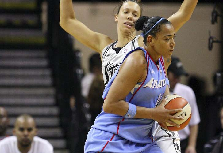 Atlanta Dream's Erika de Souza looks for room around the Silver Stars' Megan Frazee during on May 15, 2010 at the AT&T Center in San Antonio.
