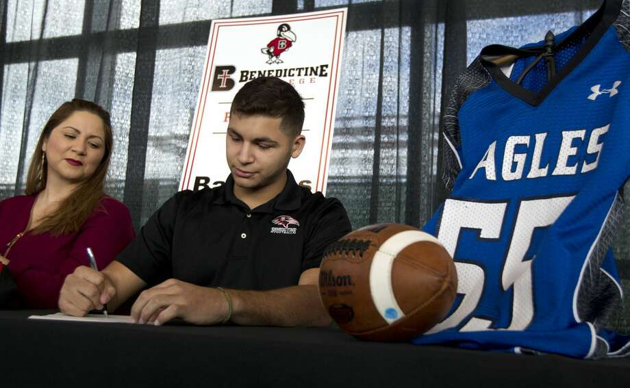 Luis Balderas signed to play football for Benedictine College during a National Signing Day ceremony at Texan Drive Stadium Wednesday, Feb. 1, 2017, in New Caney. Twenty-four athletes signed National Letters of Intent to play collegiate athletics. Photo: Catherine Dominguez/Houston Chronicle