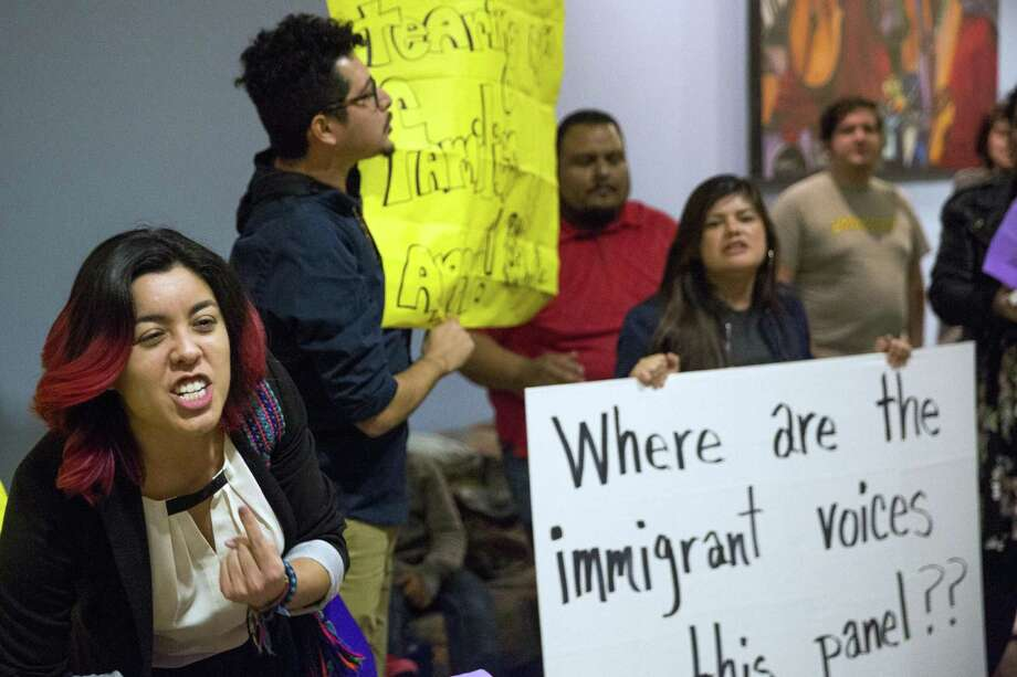 """Roxana Rojas, left, points to herself while chanting """"this is what democracy looks like"""" during a protest in solidarity with immigrants after a town hall meeting on Sanctuary Cities at UTSA in San Antonio, Texas on January 26, 2017. Ray Whitehouse / for the San Antonio Express-News Photo: Ray Whitehouse, Photographer / For The San Antonio Express-News / B641465122Z.1"""