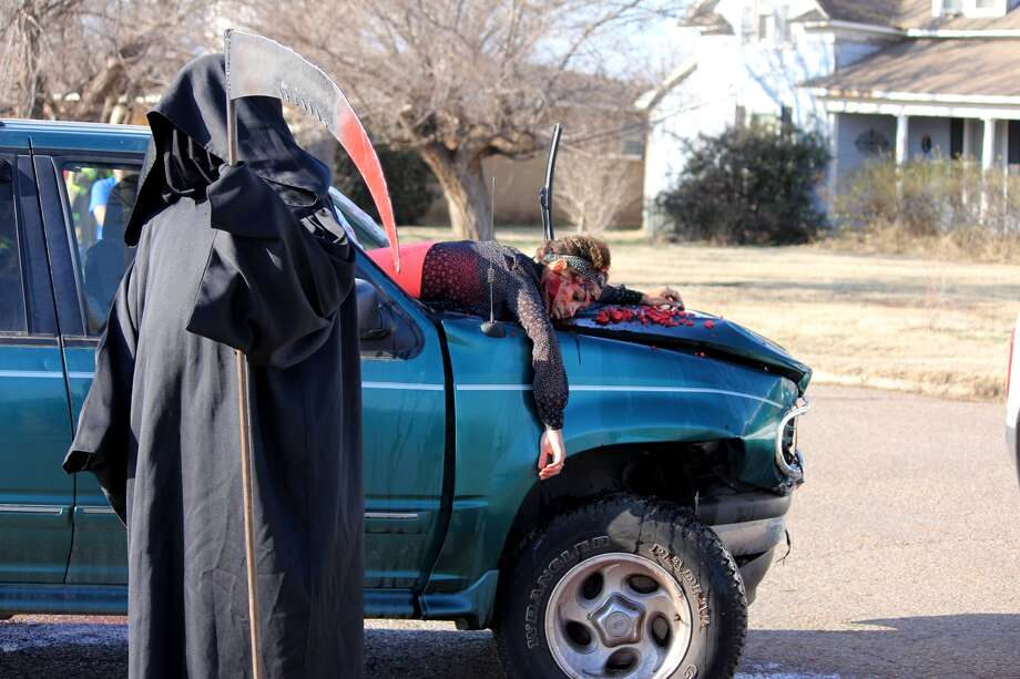 "The Grim Reaper surveys his handiwork in March 2015 after a ""victim"" was thrown through the windshield in a wreck at 12th and Smyth. The crash at the southwest corner of the Plainview High campus was staged during the semi-annual Shattered Dreams re-enactment. The two-day event for PHS juniors and seniors, which is set this year for April 6-7, highlights the dangers of driving while under the influence of drugs and alcohol or distracted by texting."