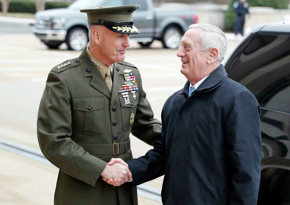 FILE - In this Jan. 21, 2107 file photo, Joint Chiefs Chairman Gen. Joseph Dunford greets Defense Secretary Jimn Mattis at the Pentagon. By visiting Japan and South Korea on his first official overseas trip, Mattis is seeking to reinforce key alliances after President Donald TrumpÂ?'s campaign-trail complaints that defense treaties disadvantaged the United States.(AP Photo/Alex Brandon, File)