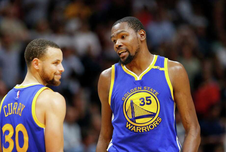 8a60efff17d Golden State Warriors forward Kevin Durant (35) talks with guard Stephen  Curry (30