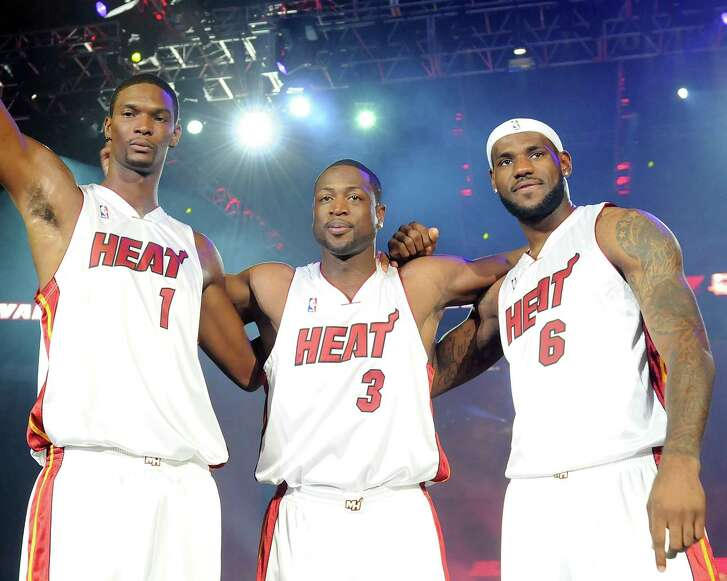MIAMI - JULY 09: (L-R) Chris Bosh,Dwayne Wade, LeBron James of the Miami Heat are introduced during a welcome party at American Airlines Arena on July 9, 2010 in Miami, Florida. (Photo by Jeff Daly/PictureGroup) via AP IMAGES