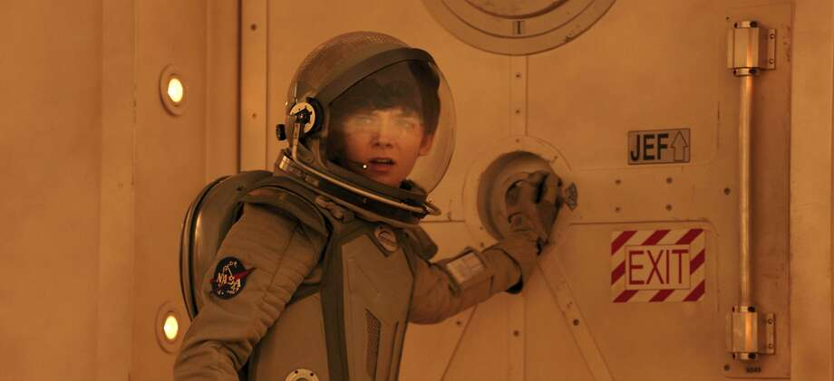 Asa Butterfield plays a boy who grows up motherless after being born on Mars. Photo: Associated Press