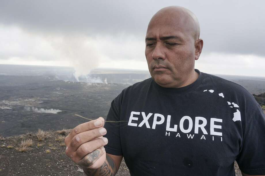 "Warren Costa of Local Guide Hawaii displays a thread of golden glass: ""Pele's hair,"" formed when ejected globs of lava pull apart. Photo: Jeff Greenwald, Special To The Chronicle"