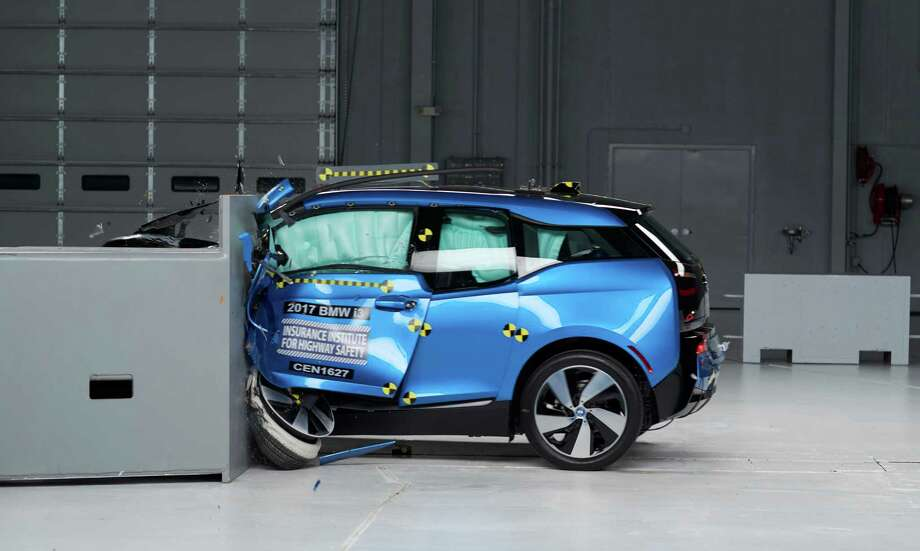 This Oct. 4, 2016, photo provided by the Insurance Institute for Highway Safety shows a 2017 BMW i3 during crash safety testing. Each year, the IIHS issues Top Safety Pick and Top Safety Pick+ awards to vehicles that are able to better protect their drivers and passengers. See which vehicles are the safest in 2017. Photo: Matt Daly, HONS / Insurance Institute for Highway Safety
