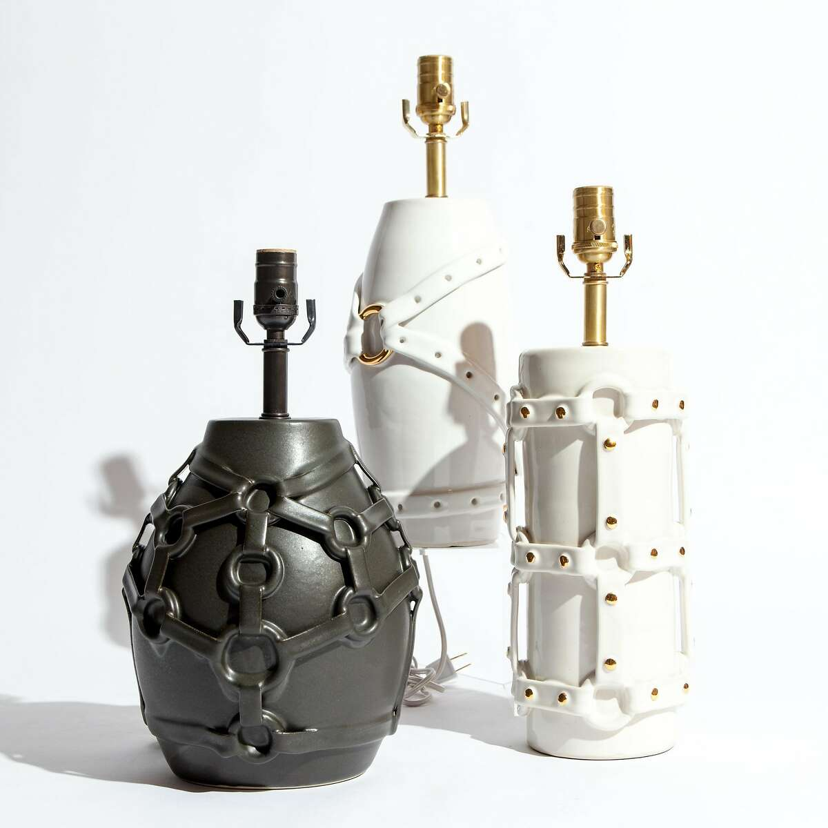 """Amanda Wright's """"Mistress"""" lamp in black, """"Brass Ring"""" lamp, $1595.00, and """"Tether"""" lamp,�$1,695.00, all part of her """"Servitude"""" collection, available exclusively at Jay Jeffers The Store."""