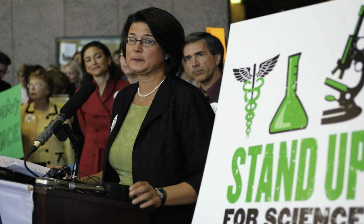 FILE PHOTO - Kathy Miller, Texas Freedom Network president, speaks during a news conference where a new science curriculum for Texas public schools was discussed Wednesday, Nov. 19, 2008, in Austin, Texas. She speaks as the State Board of Education prepares to take public testimony on proposed new standards that would encourage middle school students to discuss alternative explanations for evolution. (AP Photo/Harry Cabluck)